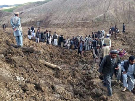 In this photo provided by Homayoon Rahmani, the chief of road reconstruction program in the Afghan Rural and Rehabilitation Development Ministry, Afghans search for survivors after a massive landslide landslide buried a village Friday, May 2, 2014 in Badakhshan province, northeastern Afghanistan, which Afghan and U.N. officials say left hundreds of dead and missing missing.(AP Photo/Homayoon Rahmani)