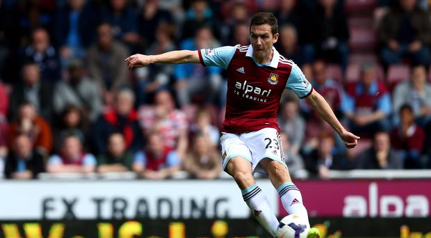 Stewart Downing of West Ham scores his team's second goal from a free kick