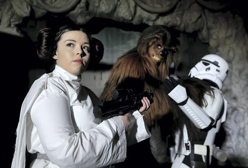 Shawna Keenan from Portarlington as Pricess Leia is joined by 'Chewbaca' and a 'Storm Trooper' at the Star Wars event in the RDS. Picture; GERRY MOONEY. 3/5/14