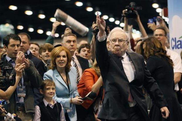 Berkshire Hathaway CEO Warren Buffett throws a newspaper during a competition at a trade show, at the company's annual meeting in Omaha, REUTERS/Rick Wilking