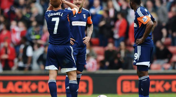 (L-R) Steve Sidwell, Konstantinos Mitroglou and Darren Bent of Fulham react as their side concedes a third goal