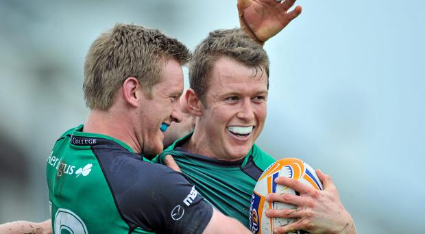 Matt Healy, Connacht, is congratulated after scoring his side's first try by team-mate Eoin Griffin