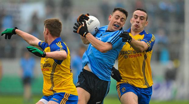 Dublin's Cormac Costello in action against Roscommon's Niall McInerney, left, and Thomas Featherston