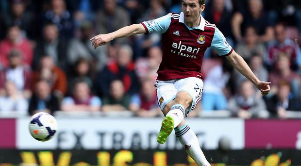 West Ham United's Stewart Downing scores his sides second goal