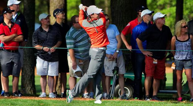 Rory McIlroy plays from the fourth fairway on his way to a third-round 65 at the Wells Fargo Championship