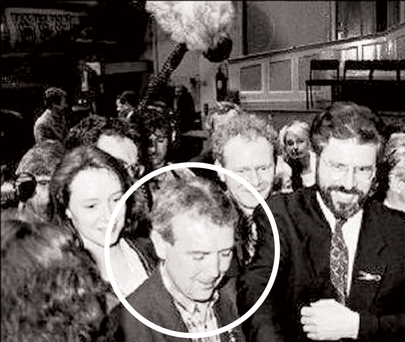 Pat McGeown photographed beside Gerry Adams.