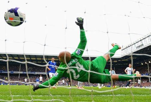 Edin Dzeko directs his header past Everton goalkeeper Tim Howard to score for Manchester City