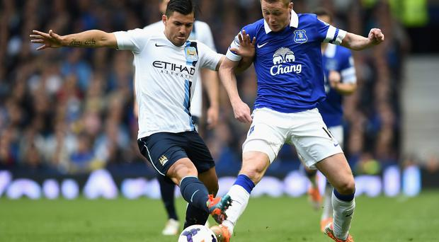Sergio Aguero of Manchester City competes with James McCarthy of Everton on Saturday