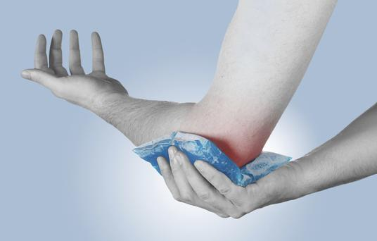 Try compression on an injury, such as a swollen elbow. Photo: Getty Images.