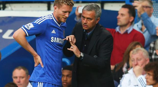 Chelsea's Andre Schurrle talks with his manager Jose Mourinho