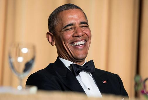 U.S. President Barack Obama laughs at a joke during the White House Correspondents' Association Dinner in Washington May 3, 2014