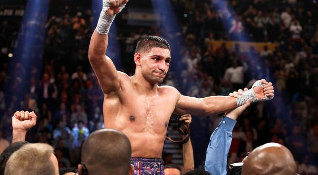Amir Khan celebrates his victory over Luis Collazo