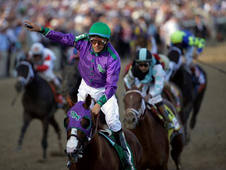 Victor Espinoza rides California Chrome to a victory during the 140th running of the Kentucky Derby