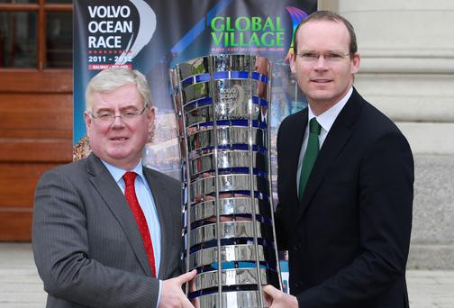 Tanaiste Eamon Gilmore and Minister Simon Coveney with the Volvo Ocean Race trophy in 2012.