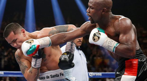 Floyd Mayweather Jr., right, connects with a right to the head of Marcos Maidana, from Argentina, in their WBC-WBA welterweight title boxing fight in Las Vegas