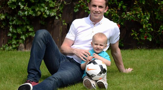 Wolverhampton Wanderers defender Kevin Foley with his son Lennon