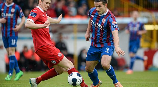 Christy Fagan on the ball for St. Patrick's Athletic is put under pressure by Jeff Henderson, Sligo Rovers