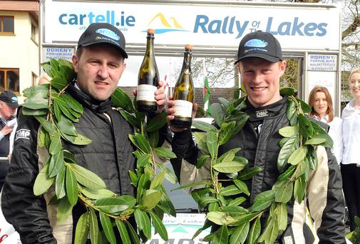 Sam Moffett, right, and James O'Reilly, overall winners, at the finish of the Cartell.ie International Rally of the Lakes 2014 at The Gleneagle Hotel, Killarney on Sunday. Organisers of the rally have disassociated themselves from some anti-social behaviour that took place in the town over the weekend. Picture: Eamonn Keogh (MacMonagle, Killarney)
