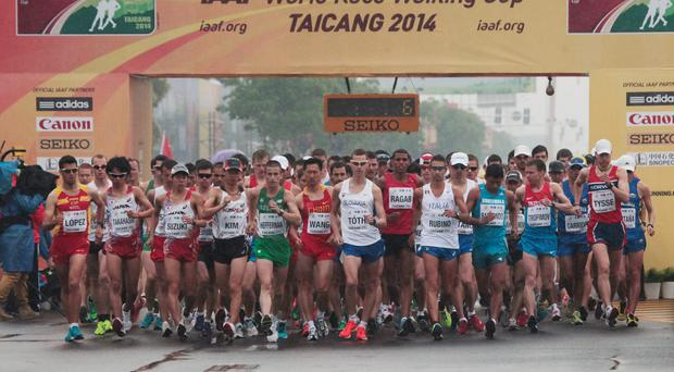 Athletes begin the Men's 20 Km Race Walk at the award ceremony during day two of the 24th IAAF World Race Walking Cup 2014 in Taicang, China