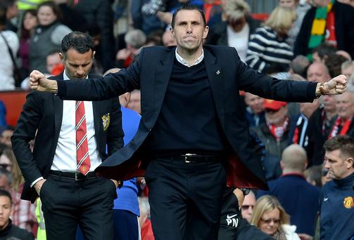 Sunderland manager Gus Poyet celebrates after the Barclays Premier League match at Old Trafford, Manchester. Martin Rickett/PA Wire.