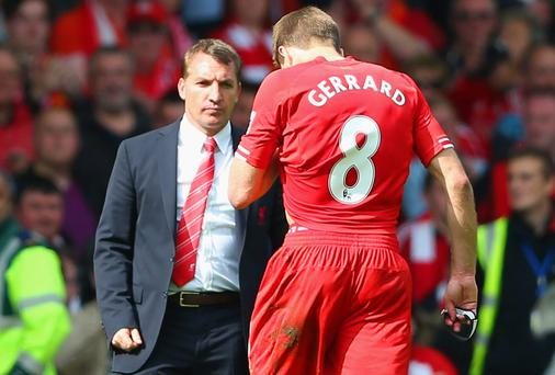 Steven Gerrard of Liverpool shakes hands with Manager Brendan Rodgers of Liverpool at the end of the match during the Barclays Premier League match between Liverpool and Chelsea at Anfield. (Photo by Clive Brunskill/Getty Images)