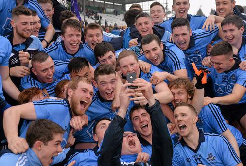 Dublin players gather for a 'selfie' as they celebrate with the cup
