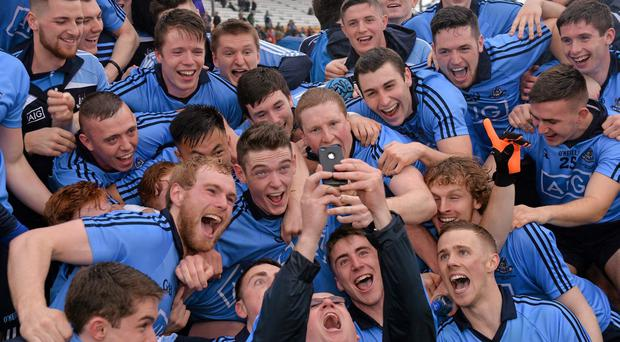 Dublin Under-21 players gather for a 'selfie' as they celebrate with the cup