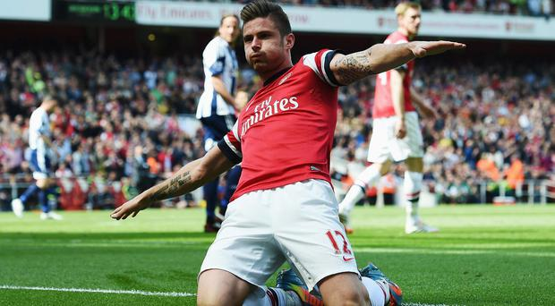 Olivier Giroud celebrates after scoring for Arsenal against West Bromwich Albion at the Emirates Stadium