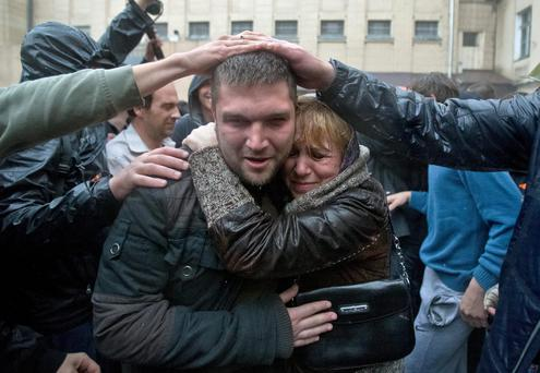 A man is greeted by supporters after being released from a local police station which was stormed by pro-Russian protesters in Odessa, Ukraine, Sunday, May 4, 2014.