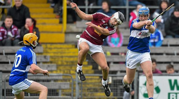 Willie Hyland, Laois, in action against Gary Greville, Westmeath
