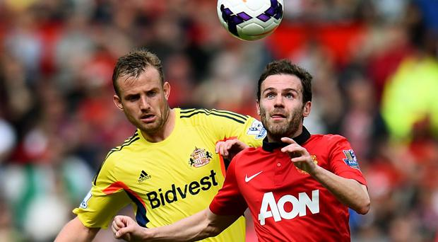 Juan Mata of Manchester United is challenged by Lee Cattermole of Sunderland during the Barclays Premier League match between Manchester United and Sunderland. (Photo by Shaun Botterill/Getty Images)