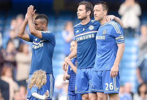 Chelsea's Ashley Cole, Frank Lampard and John Terry (left to right) during a parade of honour after the final whistle during the Barclays Premier League match at Stamford Bridge, London on May 4.