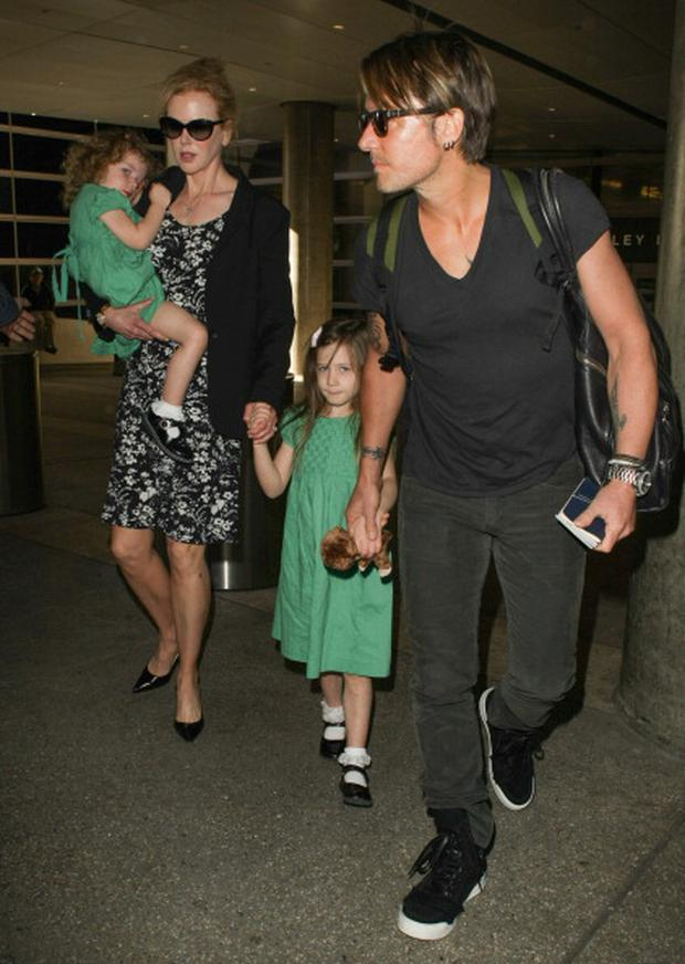Nicole Kidman, Keith Urban and their daughters, Sunday Rose Kidman Urban and Faith Margaret Kidman Urban are seen at LAX airport January 2014 (Photo by GVK/Bauer-Griffin/GC Images)