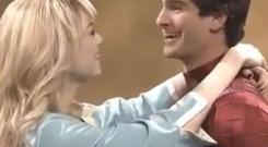 Real-life couple Emma Stone and Andrew Garfield re-create one of their famous kisses for the skit