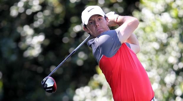 Rory McIlroy of Nothern Ireland hits a tee shot on the 14th hole during the third round of the Wells Fargo Championship