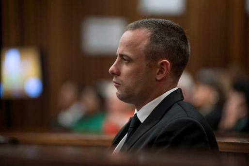 Olympic and Paralympic track star Oscar Pistorius sits in the dock in the North Gauteng High Court in Pretoria. Reuters