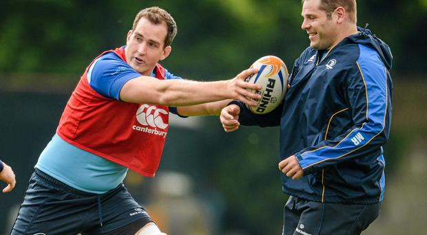 Leinster's Devin Toner, left, and Mike Ross in action during squad training