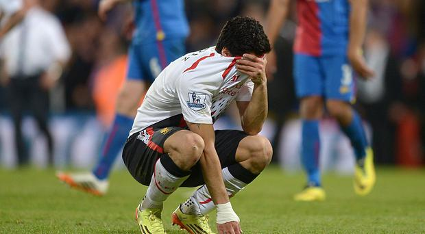 Liverpool's Luis Suarez appears dejected after the final whistle during the Barclays Premier League match at Selhurst Park. PA