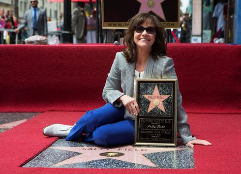 Actress Sally Field poses on her star after it was unveiled on the Walk of Fame in Hollywood, California May 5, 2014. REUTERS/Mario Anzuoni