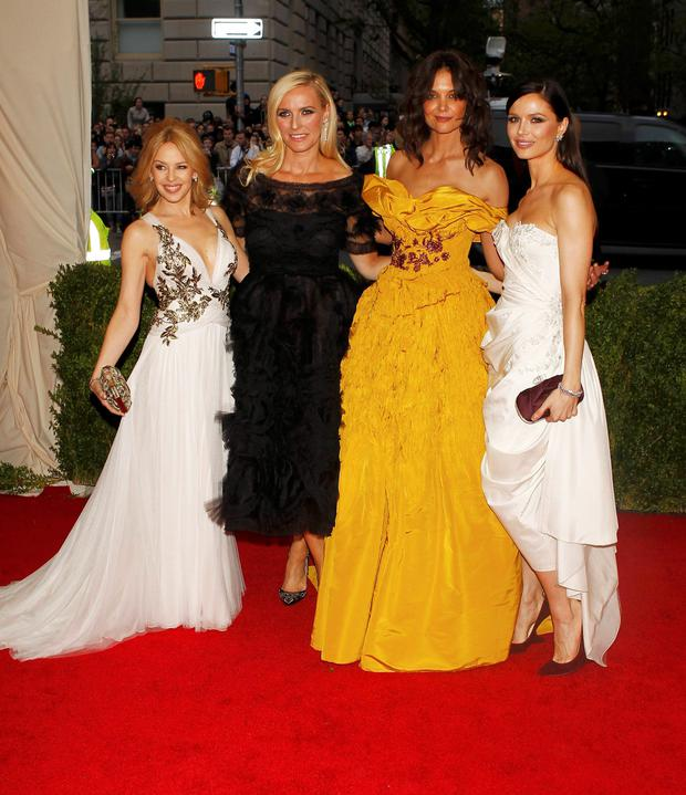 (L-R) Singer Kylie Minogue, Keren Craig, Katie Holmes and Georgina Chapman arrive at the Metropolitan Museum of Art Costume Institute Gala Benefit celebrating the opening of