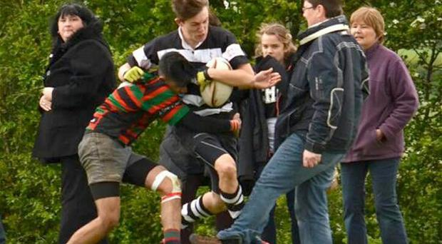 The casually dressed dad stuck his foot out as the winning side was about to romp in yet another try.