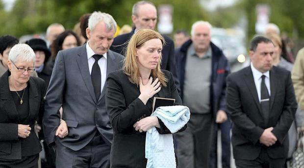 Mary Heffernan leading mourners at the funeral of her son Liam