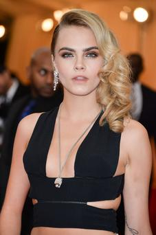 "Cara Delevigne attends the ""Charles James: Beyond Fashion"" Costume Institute Gala at the Metropolitan Museum of Art on May 5, 2014 in New York City."