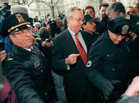 WASHINGTON, : Kenneth Starr, independent Whitewater counsel, is escorted by Washington, DC police officers after speaking at a press conference 22 January outside Starr's Washington, DC office. Starr vowed to move quickly on allegations that US President Bill Clinton had an affair with former White House intern Monica Lewinsky and then tried to cover it up. AFP PHOTO Luke FRAZZA (Photo credit should read LUKE FRAZZA/AFP/Getty Images)