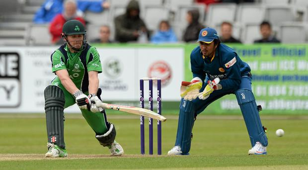 Niall O'Brien, Ireland, sweeps the ball away from a delivery off Sachithra Senanayake, Sri Lanka Picture credit: Oliver McVeigh / SPORTSFILE