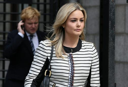 Blaise O Donnell, daughter of solicitor Brian O Donnell, pictured leaving the Four Courts yesterday after a Supreme Court action - also in picture background, her brother, Blake. Picture: Collins Courts