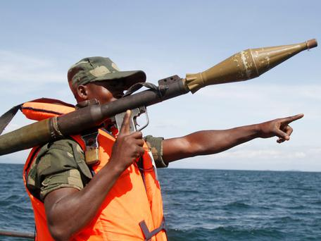 A Congolese soldier gestures as he patrols the waters of Lake Kivu in search for passengers of a boat that capsized in the lake near Goma in eastern Democratic Republic of Congo. At least one person died and a dozen others were missing after a boat capsized in eastern Democratic Republic of Congo, a spokesman for the United Nations mission in the country said on Monday. REUTERS/Kenny Katombe