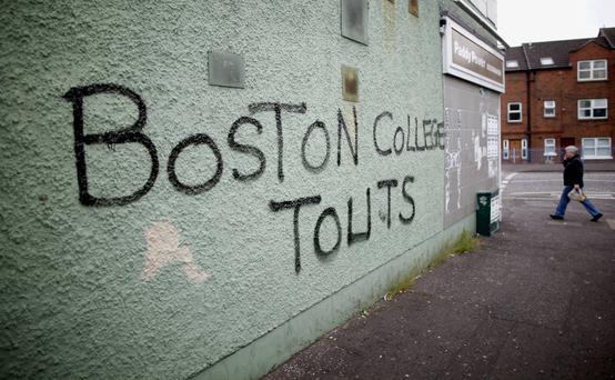 Graffiti on the Falls Road in West Belfast references Republicans who took part in the Boston College tapes project. AP