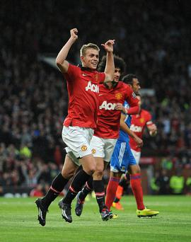 Manchester United's James Wilson celebrates scoring the opening goal during the Barclays Premier League match at Old Trafford, Manchester