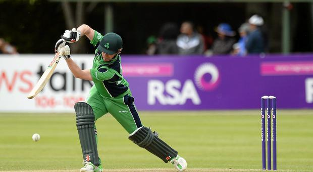 William Porterfield, Ireland, hits the ball away from a delivery off Sachithra Senanayake, Sri Lanka.
